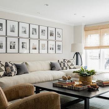 Long Cream Sofa With Chaise Lounge Under Black And White Photo Wall Cream Sofa Living Room Cream Sofa Design Cream Sofa