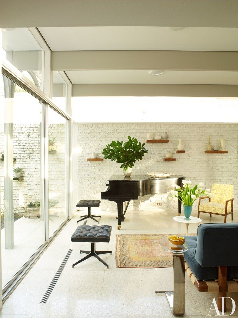 A grand piano anchors one corner of the living room. | Cool Modern ...