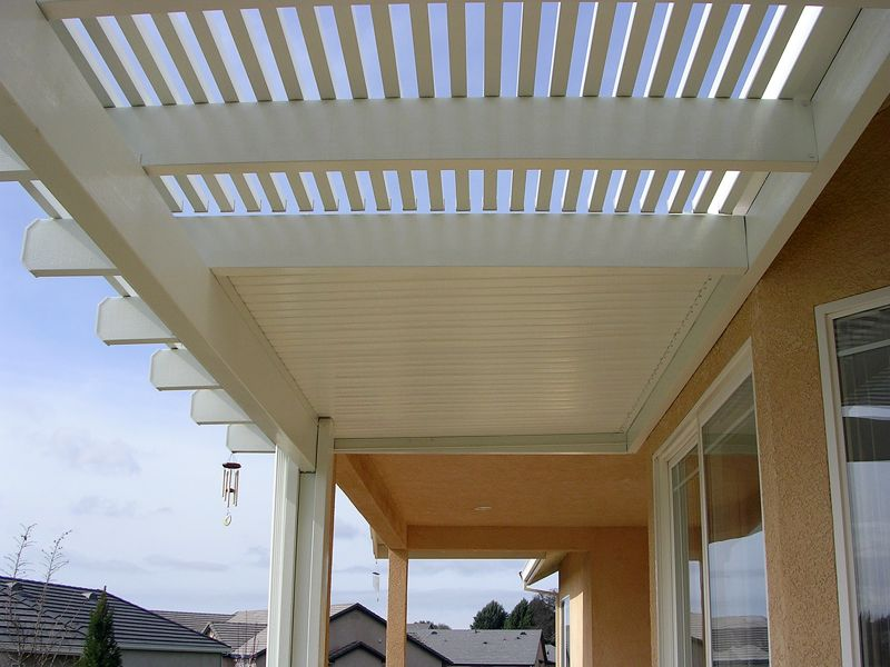 alumawood lattice and solid combo patio cover in white garden