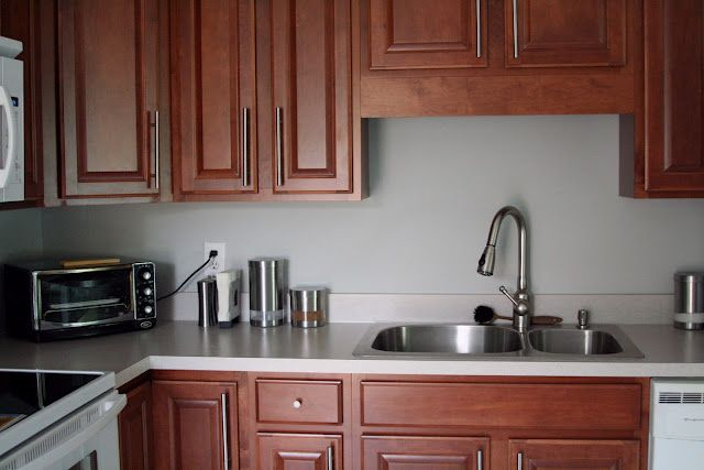 Sherwin Williams Krypton With Artificial Light Basement And Cherry Cabine Cherry Cabinets Kitchen Wall Color Kitchen Paint Colors With Cherry Cherry Cabinets