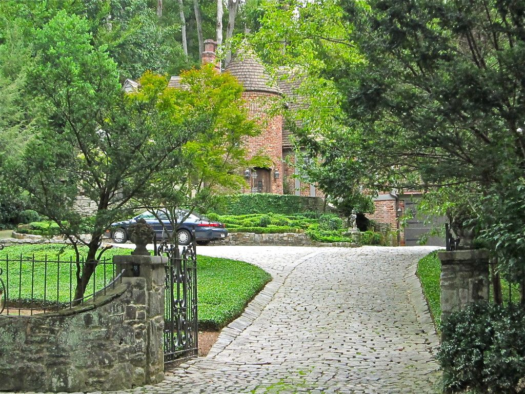 Front gate and cobblestone driveway–welcome fences and