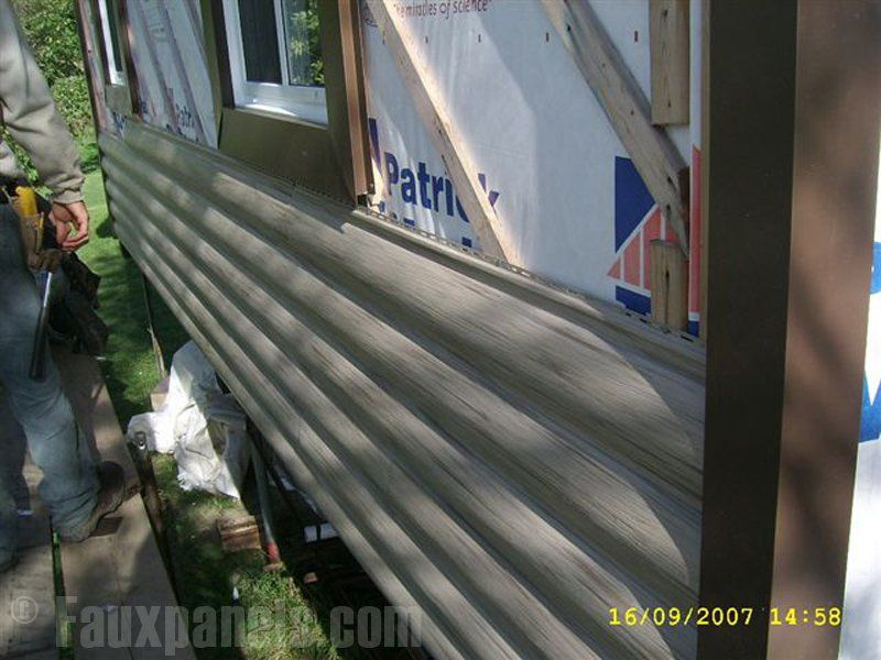 Faux Log Siding Going Up On A Home Shows Just How Simple The Process Can Be Log Cabin Vinyl Siding Vinyl Siding Log Siding