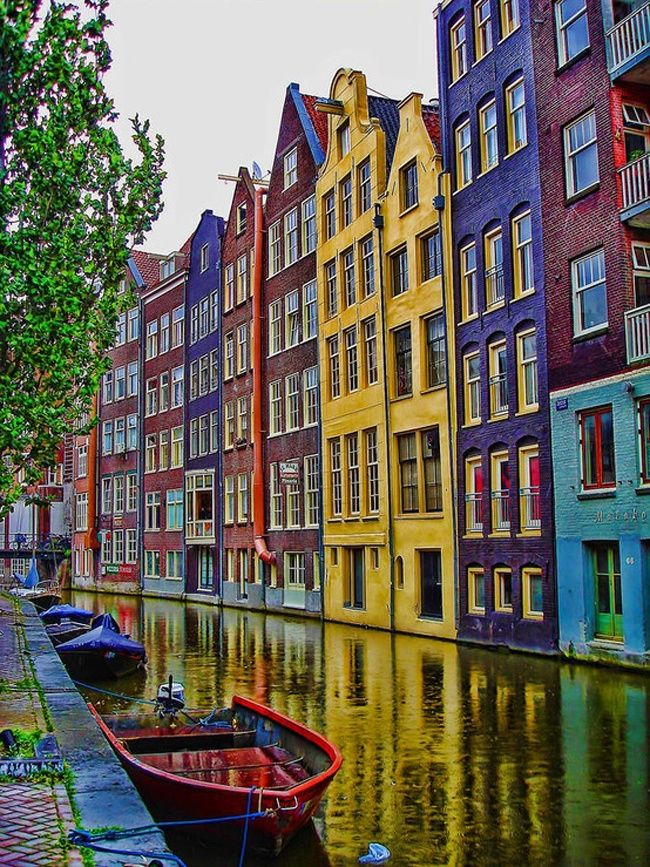 The Unique Houses On The Water Of Amsterdam The Netherlands.