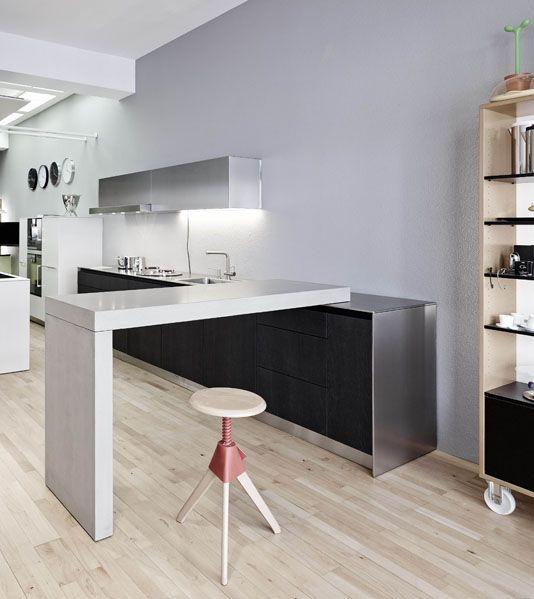 eine k chentheke aus beton berzeugt mit einer. Black Bedroom Furniture Sets. Home Design Ideas