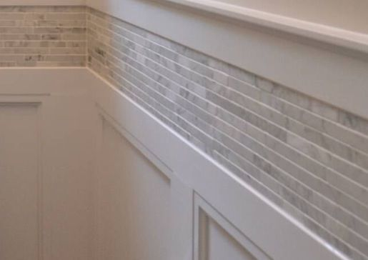 Wainscoting With Tile Border Above Crown Moldings