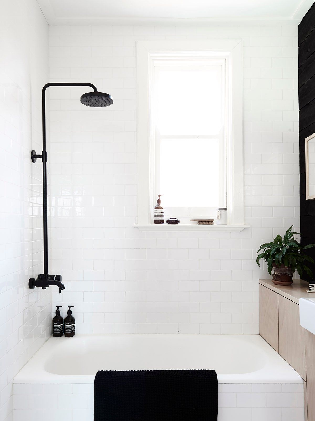 White bathroom with black accents. Swedish Summer House by Mr.Fräg ...