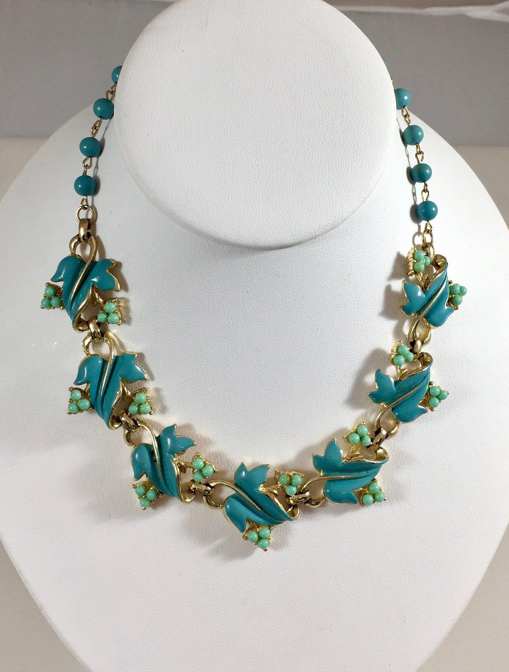 Vintage Goldtone Choker Necklace with 15 Round Blue Rhinestones Adorning a Huge Leaf Pendant ** **RL