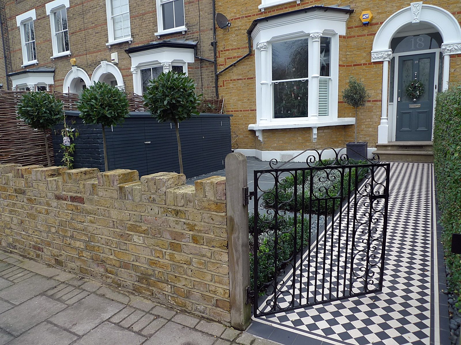 london yellow stock brick garden wall with black and white