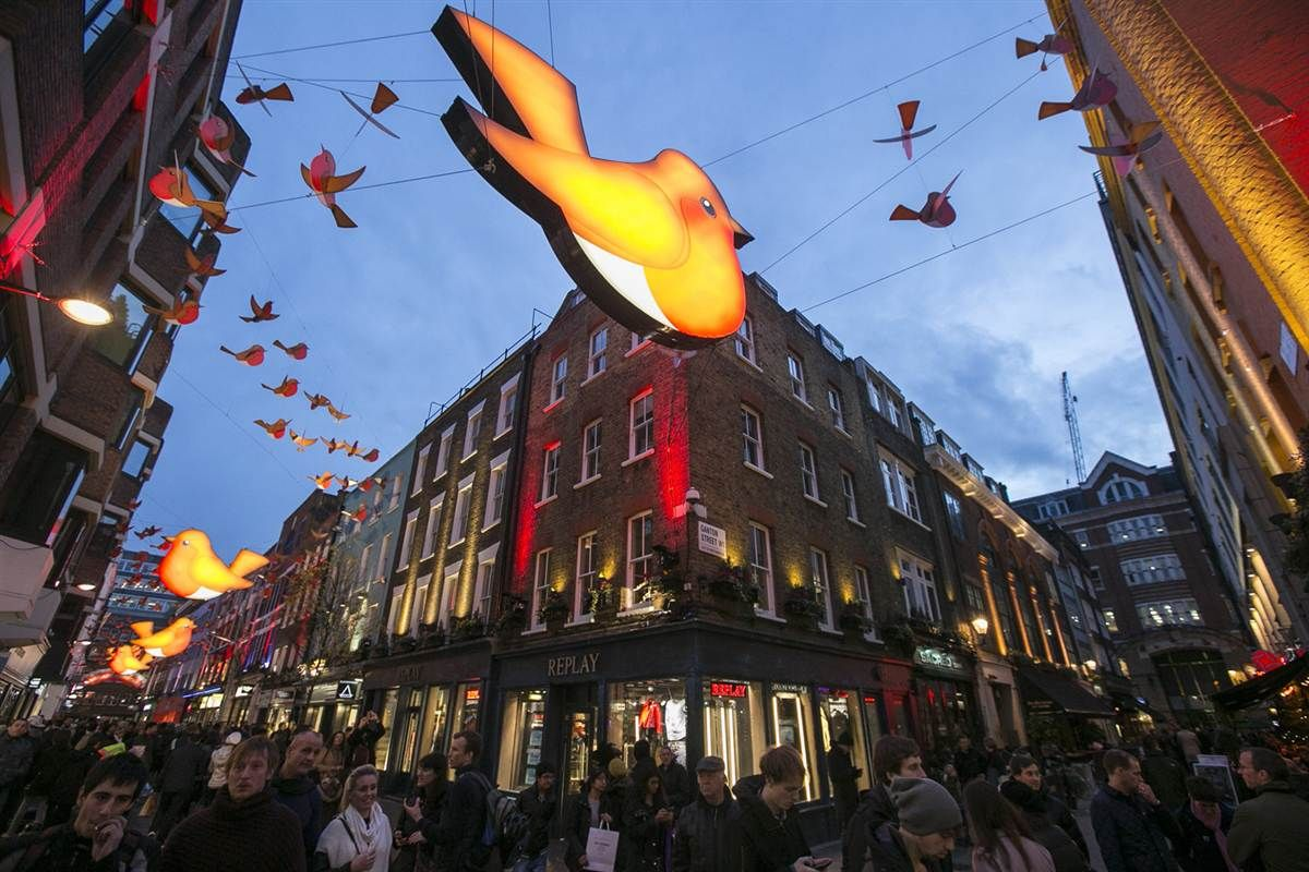 Christmas shoppers mingle on London's Carnaby Street on Dec. 14.