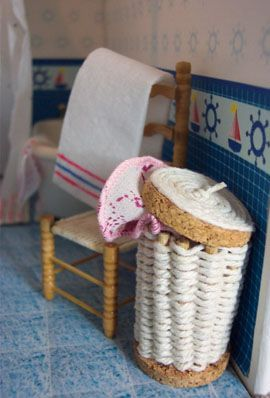 """Laundry hamper made from """"cork rings, toothpicks and string"""" 