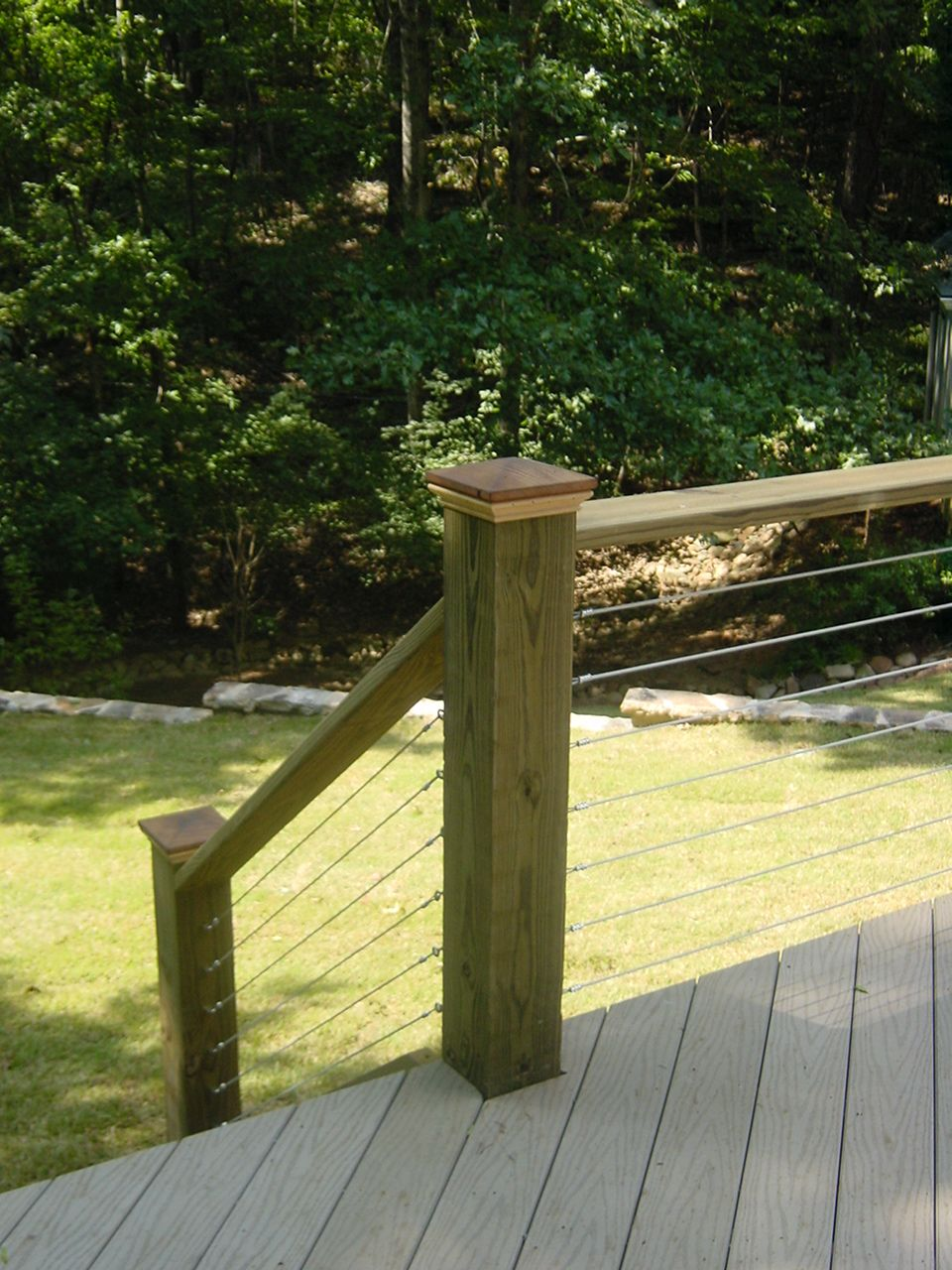 Wire And Wood Railing On A Deck That I Designed While