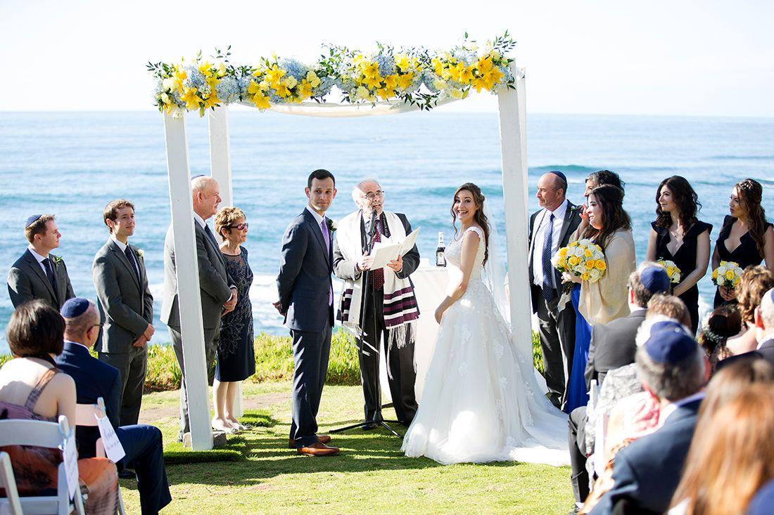 Beach wedding venues in san diego  Yellow and Blue Wedding Arch  Yellow roses blue hydrangea