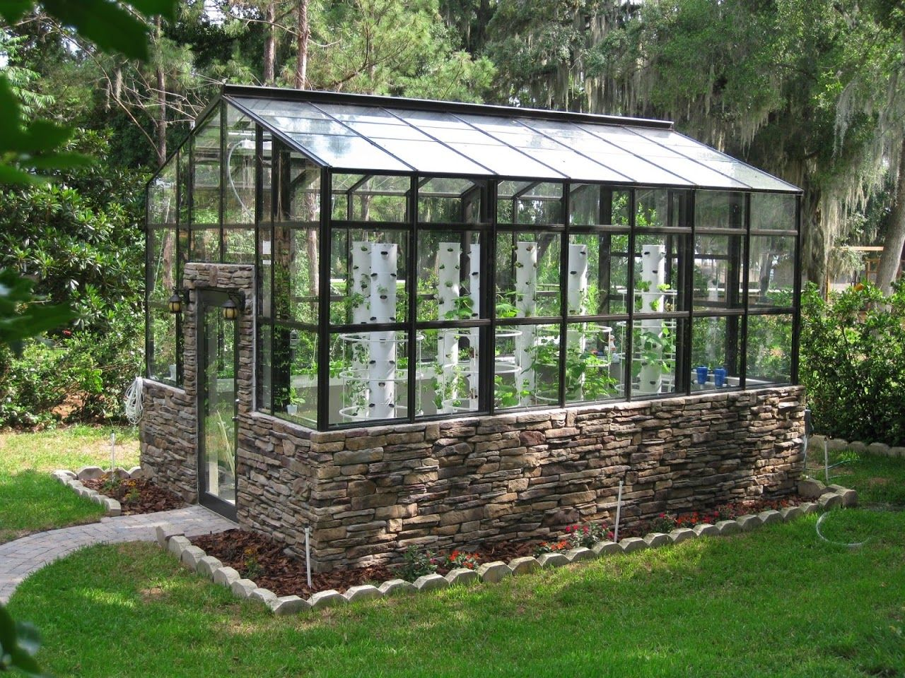 Future Growing Tower Gardens In Small Urban Greenhouse Modern Greenhouses Tower Garden Urban Garden