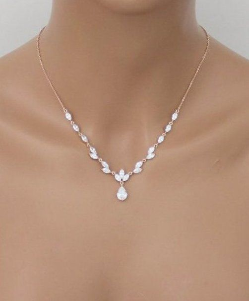 Sparkling rose gold finish necklace and earring set made of marquise cuts cubic zirconias and a single tear drop cut that dangles in the center with matching earrings  This beautiful set is both lovely and radiant  the perfect accessory set for any formal event that is in need of a #GoldJewelleryAwesome