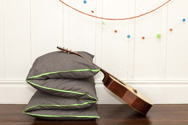 ZIPillow. Cool. Can be configured a bunch of ways. With neon zippers in green and orange.