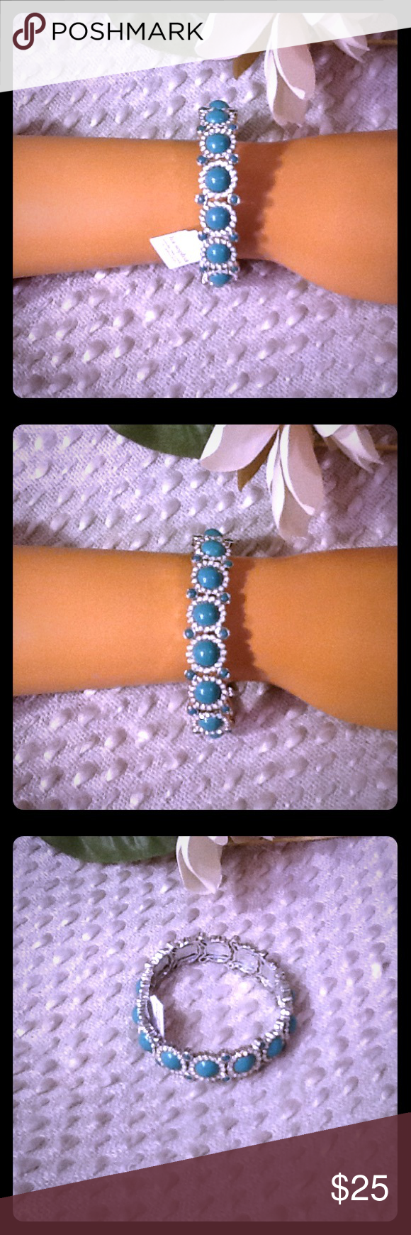 Lia Sophia Stretch Bracelet NWT Blue Silver Beautiful Lia Sophia stretch bracelet, NWT, beautiful blue colored stones surrounded by white crystal rhinestones, should fit most wrist sizes. Bundle to save 15% off your purchase of 2 or more items from my closet! Lia Sophia Jewelry Bracelets