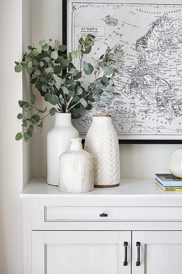 Photo of Large Black and White Map Art  White Vases  Eucalyptus Greenery  Styling a co