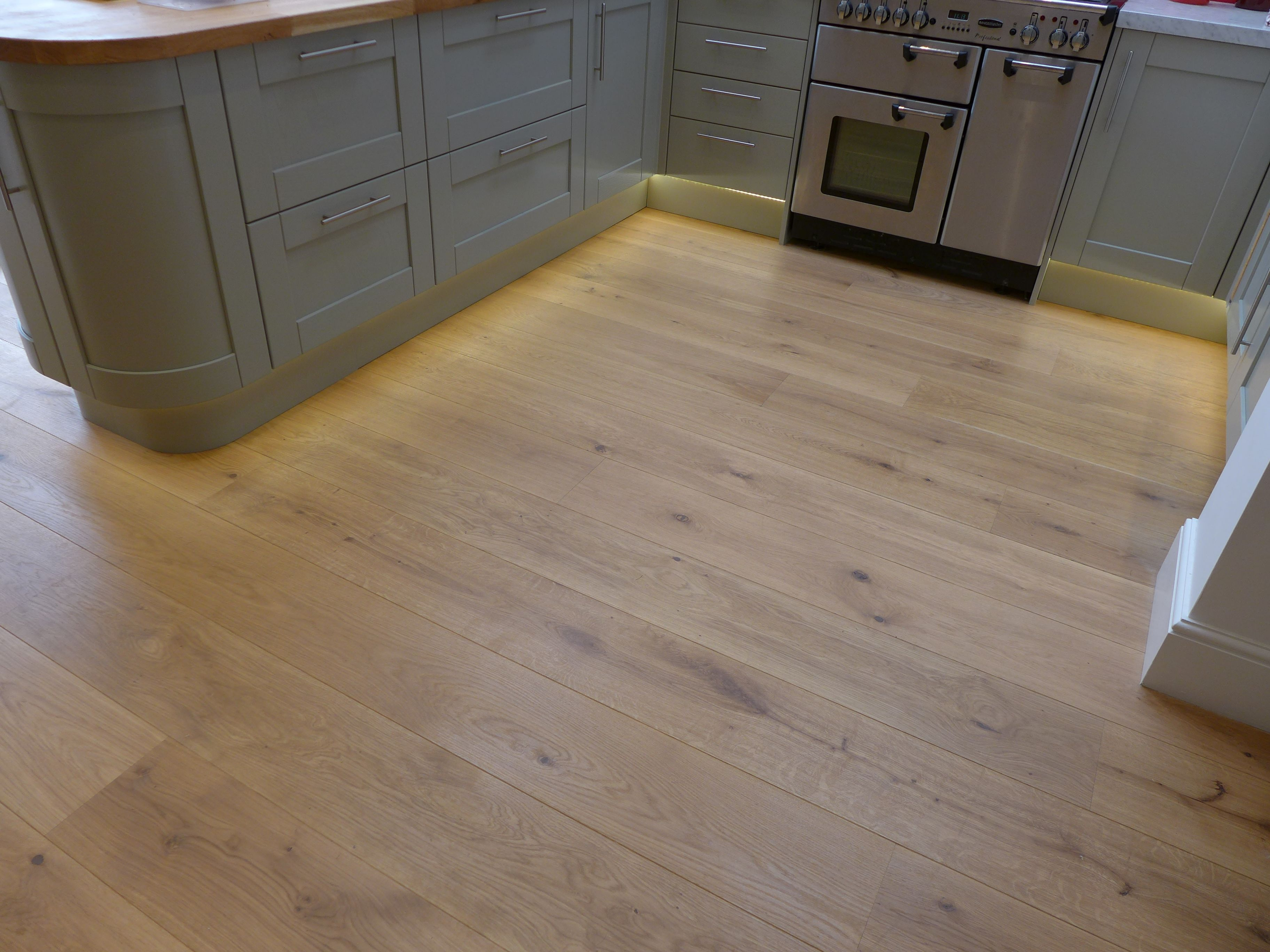 Led Strip Plinth Lighting Adds Warmth To This Oak Kitchen Floor