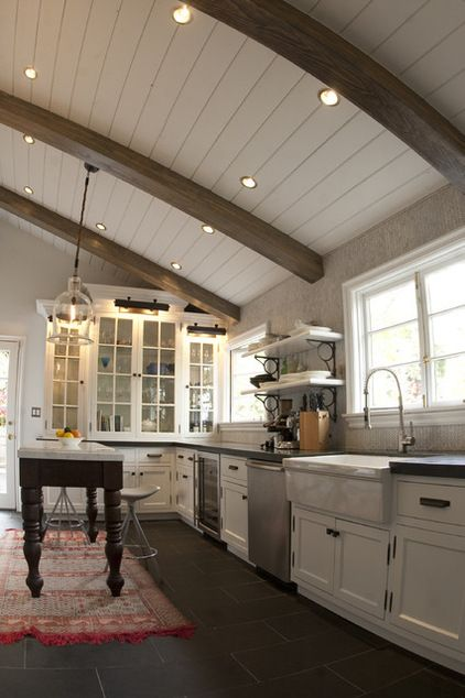 White Shiplap Vaulted Ceiling With Stained Beams