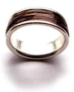 A sterling silver or gold ring with your horsehair set into a clear