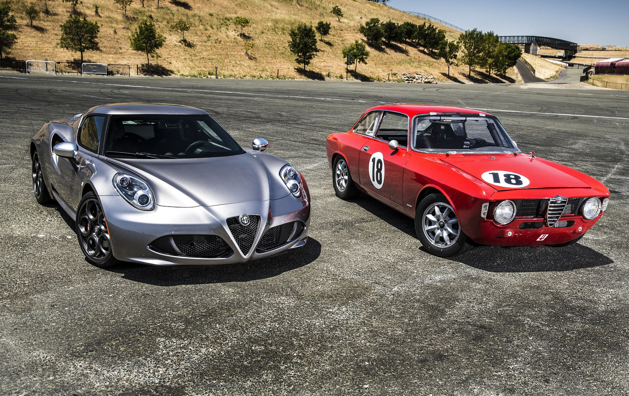 2015 Alfa Romeo 4C left and vintage Alfa Romeo GTV right