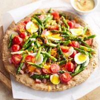 One of BHG's Newest Recipes: Spring Breakfast Pizza with Spiced Hollandaise - Wake up to the works -- cheesy asparagus, hard-cooked eggs, juicy tomatoes, and honey ham -- all on one golden, flaky crust.