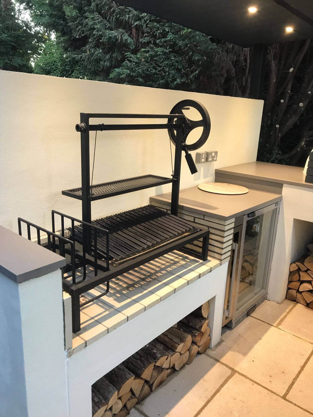 argentinian grill with beer fridge wine fridge and pizza oven