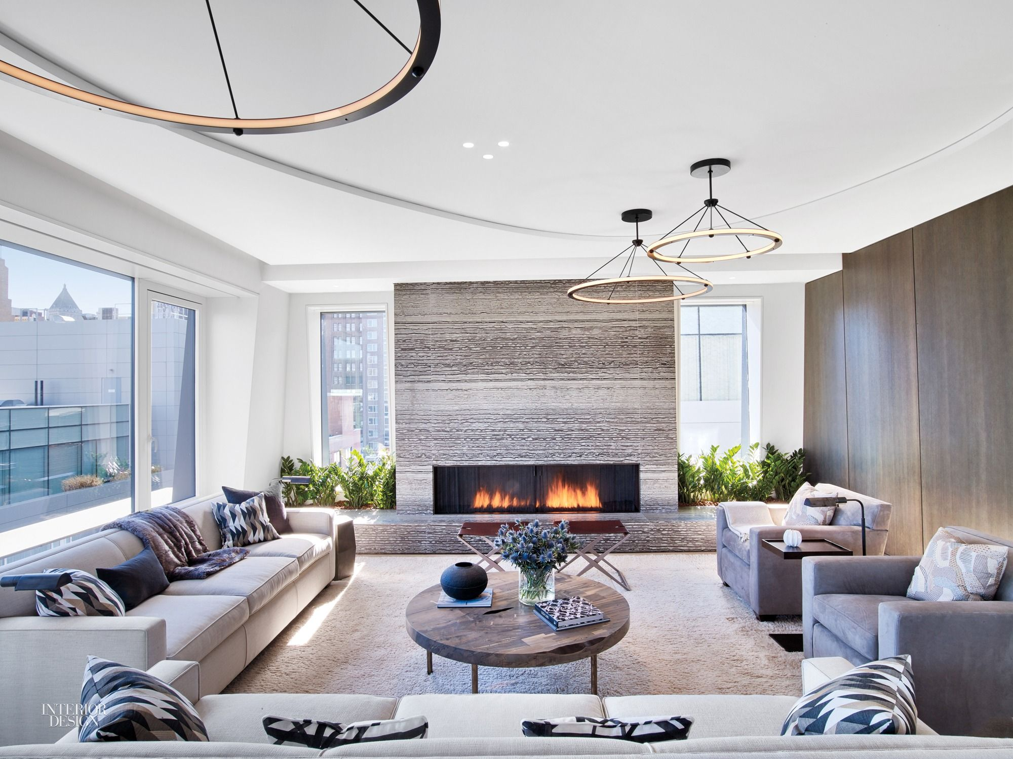 Centered fireplace surrounded by striated bosco marble home living room area interior architecture also simply amazing fireplaces pinterest pent house rh