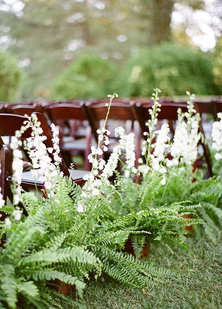 wedding ceremony seating flowers - photo by Lacie Hansen http://ruffledblog.com/utterly-beautiful-california-wedding-planned-by-the-bride