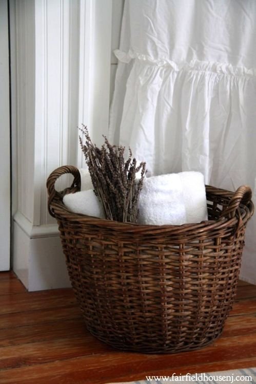Vintage wicker basket backed by crispest white towels...lovely in a guest bathroom