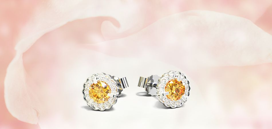 Ice `n Fire, #devindt new orange diamond collection. STUD EARRING : 0.30 ct #orange #diamond and 14 Canadian #white #diamonds. €1499 inc Tax