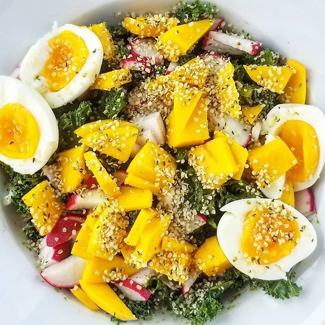 Kale + Mango + Radish + Hemp Seed + Soft Boiled Eggs. The kale was soaked in a homemade Cilantro-Artichoke Pesto. Recipe from @drjolenebrighten. Check her out!! . . .