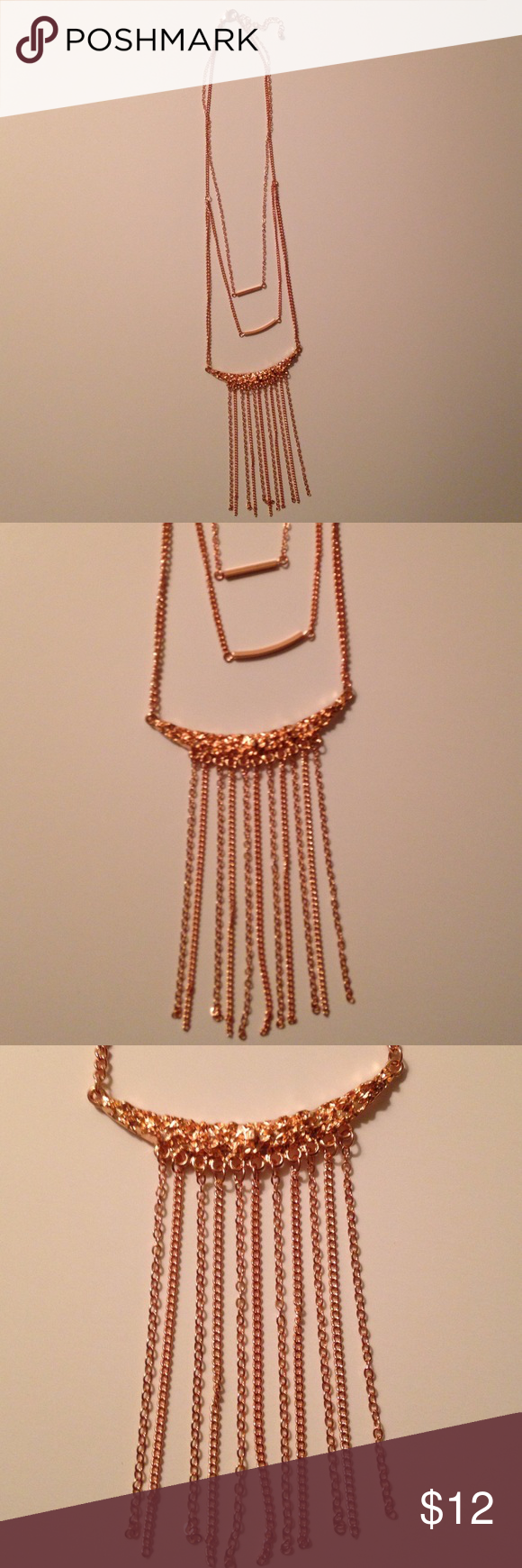 NWT rose gold color necklace Rose gold color necklace has two bar pendants and a cascading chain pendant. The shorter bar is is 3/4 inches across. The next bar is 1 inch across and the cascading chains are 3 inches long. The necklace is 22 inches long with a 3 inch extender Jewelry Necklaces