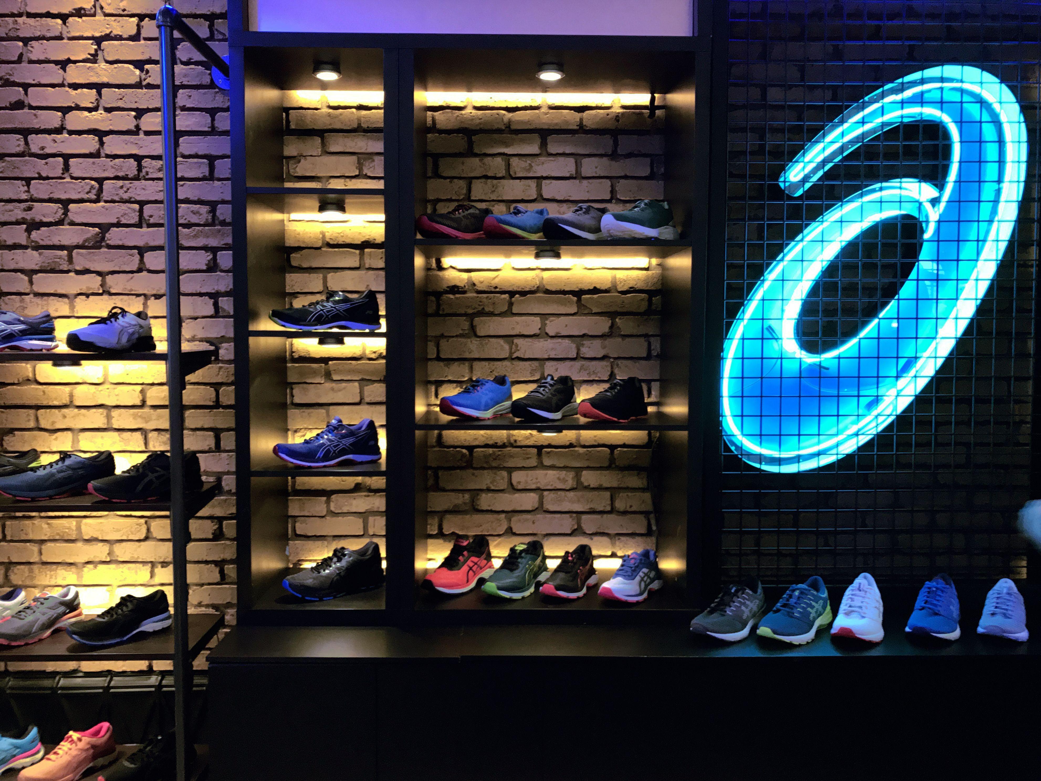 Shoe display at the #ASICS Neon Brewpub