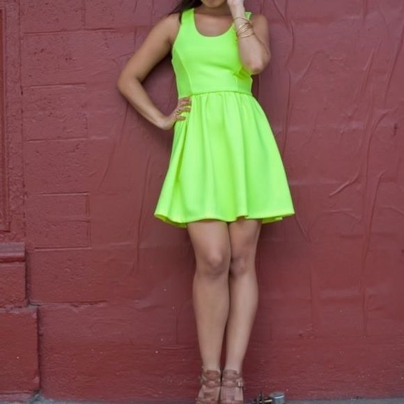 Neon Dress L'Amour By Nanette LeporeSleeveless Back-Zip Babydoll Dress in Neon Yellow. Flattering silhouette and exposed back zipper. Dress it up with heels and a jacket or go casual with sandals. Worn once, excellent condition.   Shell: 93% Polyester / 7% Spandex Lining: 100% Polyester Hand wash. Dry flat. Nanette Lepore Dresses Mini