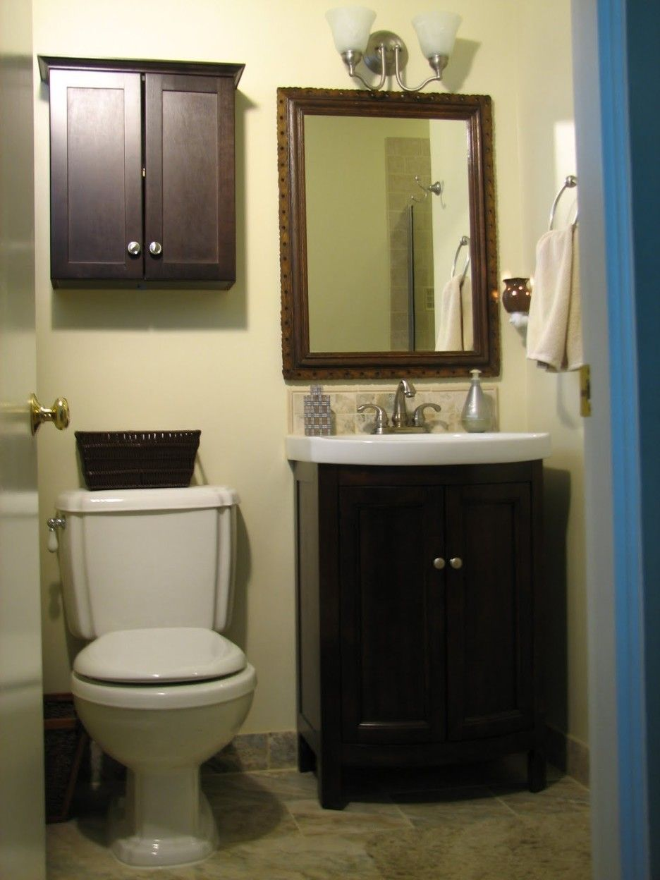 Bathroom Small Dark Brown Wooden Cabinet With Double Doors Also White Toilet Under It Combined