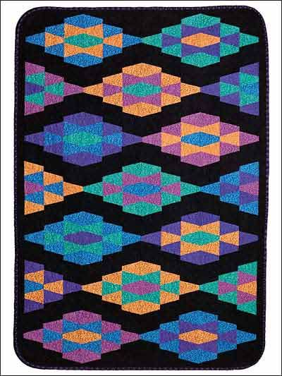 The Amish Medallion quilt combines bright colors with a black ... : bright colored quilt patterns - Adamdwight.com