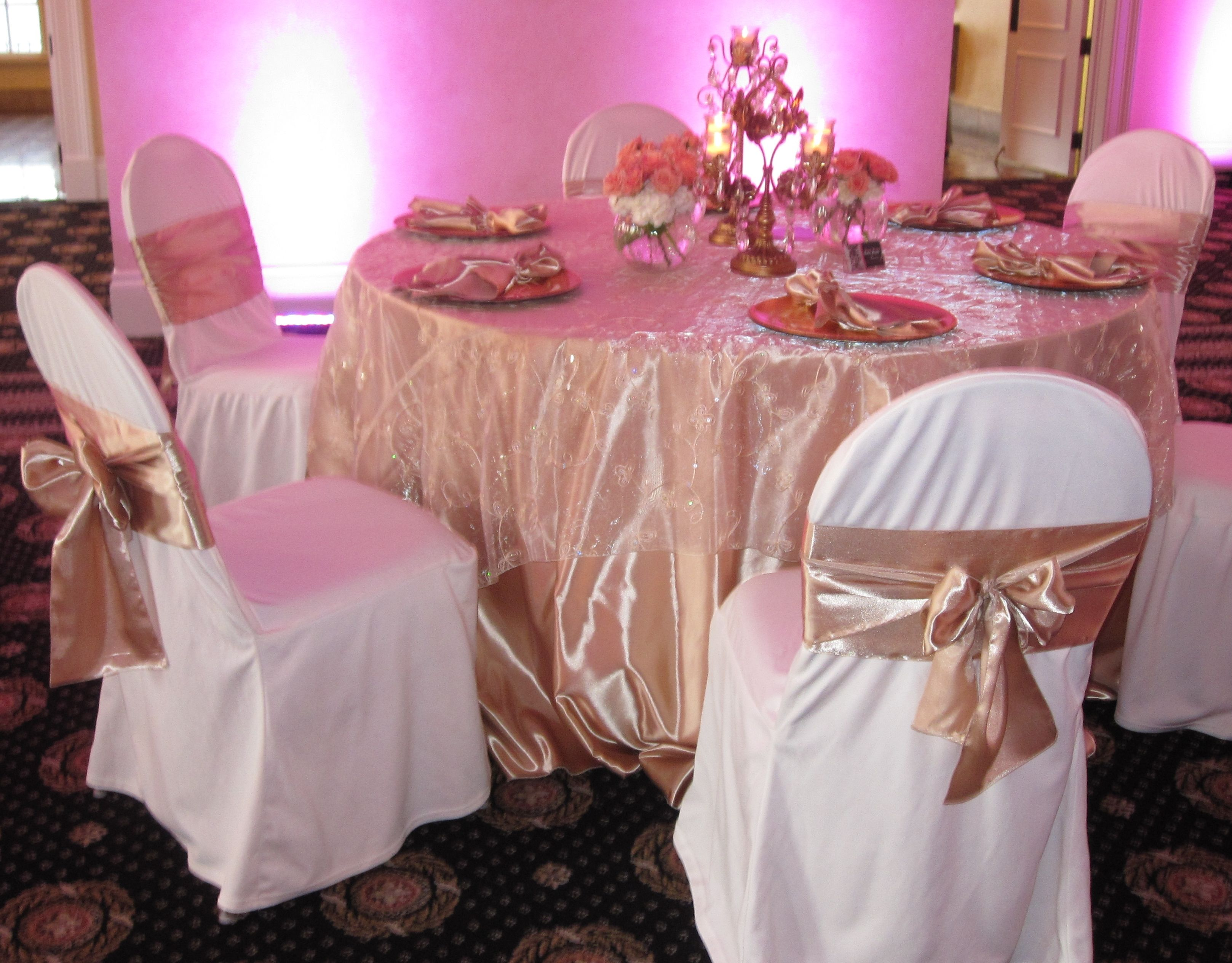 Golden Champagne Satin Tablecloths With Champagne Embroidered Sequins Overlay Ivory Chair Covers And C Wedding Chair Sashes Wedding Chairs Wedding Decorations