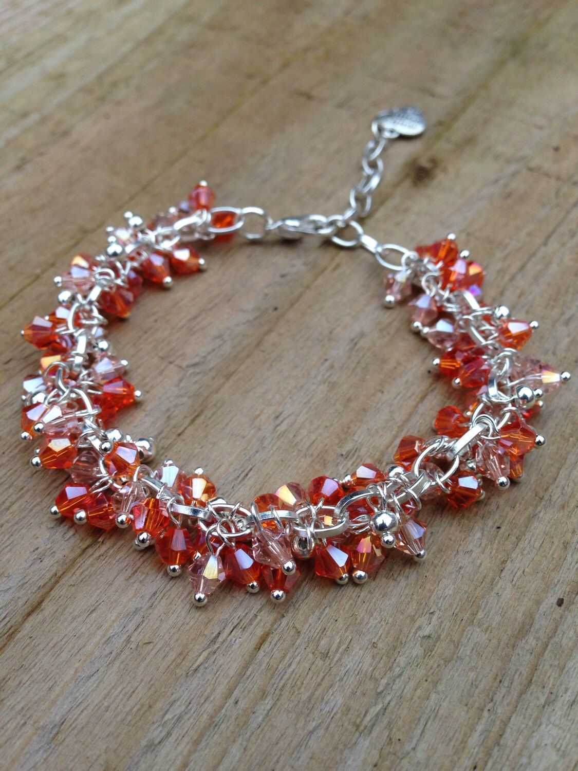 A personal favourite from my Etsy shop https://www.etsy.com/uk/listing/246674126/orange-sparkly-beaded-bracelet-featuring