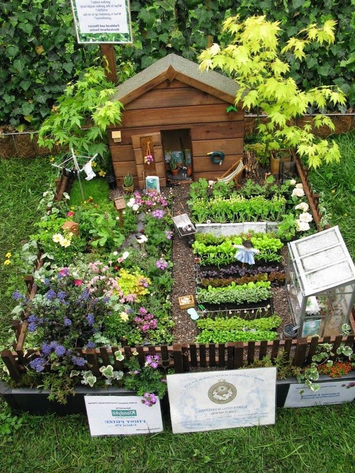 Vegetable And Flower Beds Of Miniature Size Inside A Tiny