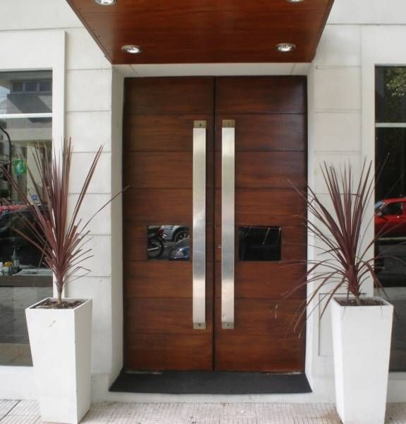 Interior Sustainable Home Design Double Wood Front Doors A Side Mirror Featuring Seat Handle Set Door And Plant On White Pot Modern Entry