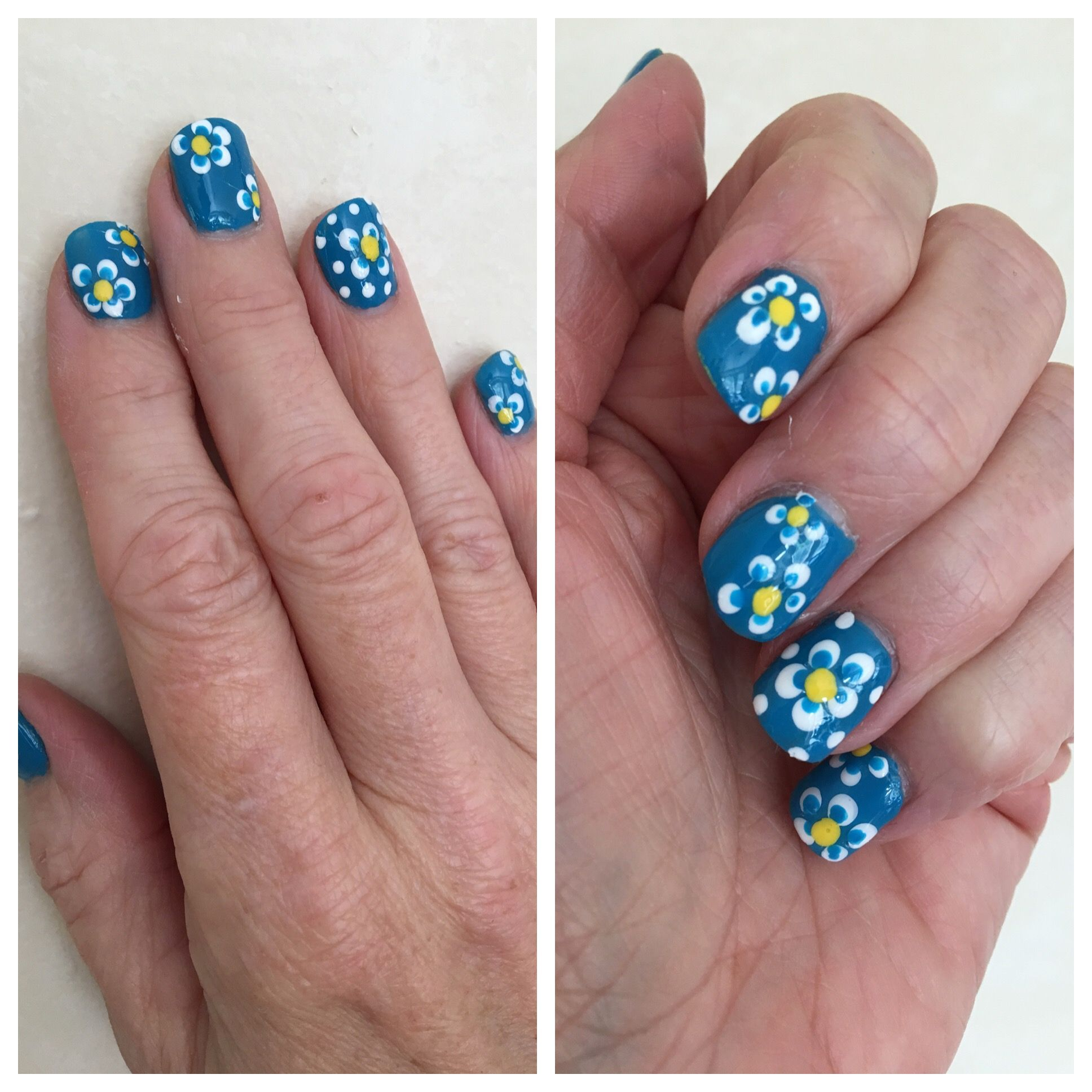 Dotting tool daisies on blue background nail design | Nails I\'ve ...