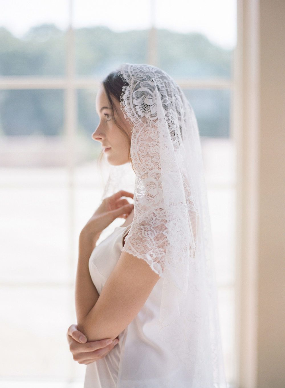 Feminine french bridal fashion shoot veils flower crowns halos