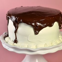 banana cream tuxedo cake - banana cake filled with pastry cream, covered with whipped cream, and drizzled with chocolate ganache
