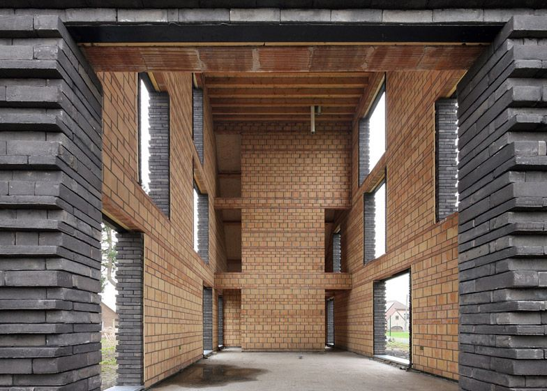 Ribbed brickwork covers the facade of this house in