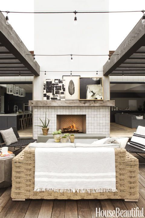 Modern Farmhouse Big Space Bigger Details Just Outside A Gas Fireplace With Glazed Terra