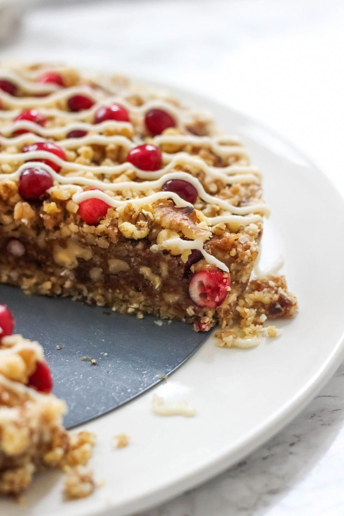 This No-Bake Cranberry Walnut Tart comes together in just minutes and makes great addition to your Thanksgiving or holiday dessert table! Full of walnuts, dates, and cranberries, your guests will be be going for seconds of this guilt-free dessert #vegandessert #glutenfree #paleodessert #nobaketart #cranberrydessert #walnuttart #bakedambrosia #holidayvegandessert