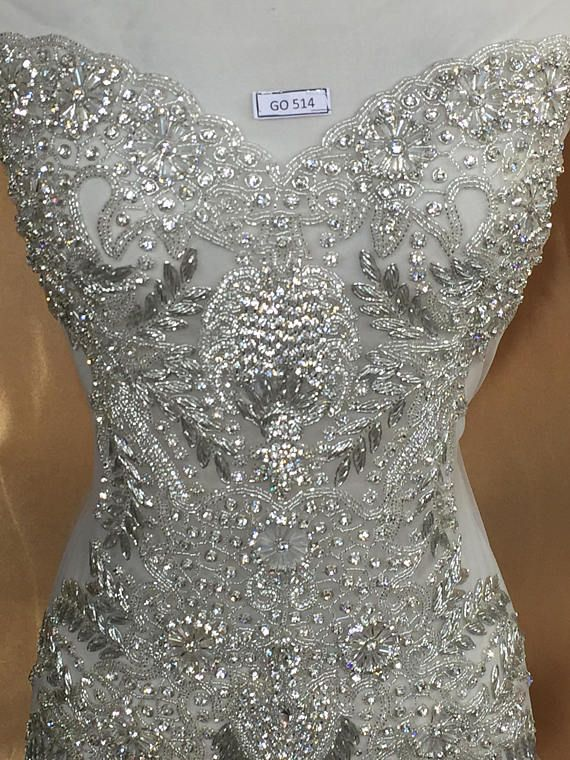 This beautiful applique is handmade with top quality Crystal rhinestones.  The applique is attached to a mesh backing to make it super easy for DIY  projects. 727e1e7982f3
