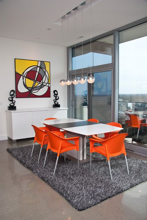 Modern Dining Room Decor With White And Gray Table Orange Chairs Shag