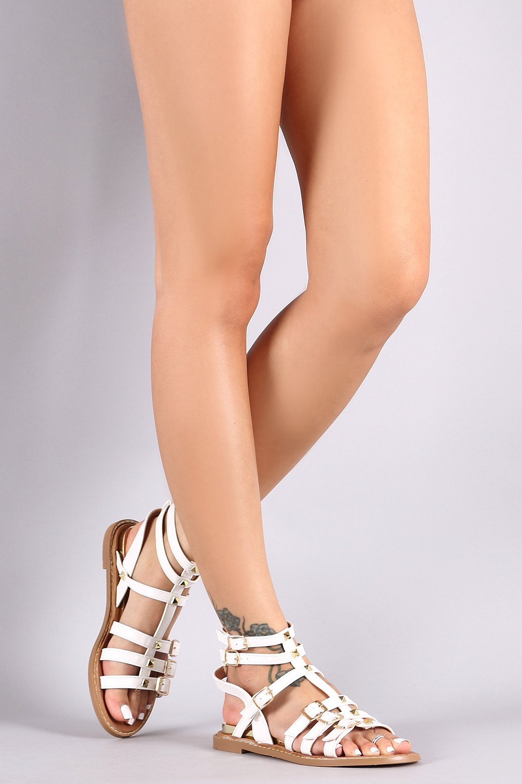 71f86c6c2238 These gladiator sandals features a smooth vegan leather material
